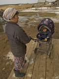A Nenet Woman and Her Baby Wait Outside a Store in Snopa Village Photographic Print by Gordon Wiltsie