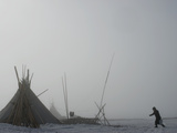 A Komi Reindeer Herder Carries Snow to Her Chum to Melt for Water Photographic Print by Gordon Wiltsie