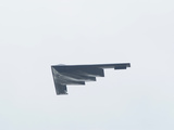 A United States Air Force B-2 Spirit or Stealth Bomber in Flight Photographic Print by Raul Touzon