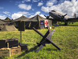 Replica WWII Army Airfield with DC-3 Plane, Medic Tent and Munitions Photographic Print by Pete Ryan