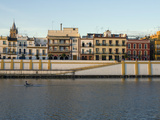 Rower at Sunrise on the Guadalquivir River by the Triana Neighborhood Fotografiskt tryck av Krista Rossow