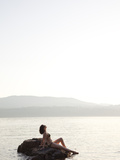 A Woman Sunbathes on a Hot Summer Day by the Ocean Photographic Print by Taylor S. Kennedy