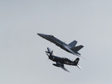 A Us Navy F-18 Hornet an F-4 Corsair Flying in Formation Photographic Print by Raul Touzon