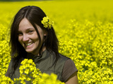A Young Woman in a Field of Rapeseed, Brassica Napus Photographic Print by Joe Petersburger