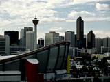 A View of Calgary's Skyline with the Saddledome in the Foreground Photographic Print by Kenneth Ginn
