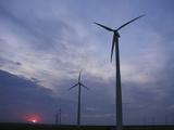 Wind Turbines Silhouetted Against Sunset in Kansas Photographic Print by  Greg