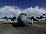 A C-130 Parked on an Airfield Photographic Print by Raul Touzon