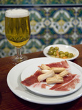 Tapas of Jamon Serrano and Olives at Taberna Coloniales in Seville Fotografiskt tryck av Krista Rossow