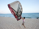 A Young Woman Runs on the Beach with Her Kite in Mui Ne, Vietnam Photographic Print by Kris Leboutillier