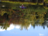 A Kayaker Looks Through Binoculars Photographic Print by Raul Touzon
