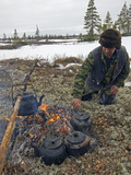 A Komi Reindeer Herder Makes Tea During Reindeer Calving Season Photographic Print by Gordon Wiltsie
