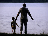 A Man and a Boy Fishing Along the Shore of Lake Banyoles Photographic Print by Tino Soriano