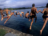 Men Jumping into Lake Banyoles Photographic Print by Tino Soriano