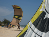 Kite Surfing Instructor Holds a Kite on the Beach in Mui Ne, Vietnam Photographic Print by Kris Leboutillier