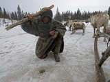 A Nomadic Komi Reindeer Herder Fishes in a Hole with Primitive Gear Photographic Print by Gordon Wiltsie
