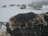 Sleds Stacked with Reindeer Hides and Other Belongings for Migration Photographic Print by Gordon Wiltsie