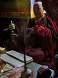 A Tibetan Buddhist Monk Praying in Dhankar Gompa Photographic Print by Steve Winter