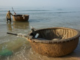 Fishermen Bring their Basket Boats Up on the Shore Photographic Print by Kris Leboutillier