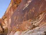 A 4-Foot-Tall Shaman Figure and Other Glyphs Decorate a Rock Face Photographic Print by Pete Ryan