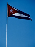 The National Flag of Cuba Flying Against a Blue Sky Photographic Print by Kenneth Ginn