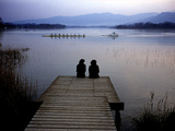 A Crew Boat and Women Sitting on a Dock on Lake Banyoles Photographic Print by Tino Soriano