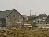 An Old Boat Sits Amongst Sheds and Houses in Snopa Village Photographic Print by Gordon Wiltsie