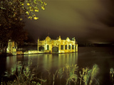 Glow of Fireworks Above a Boathouse on Lake Banyoles at Night Photographic Print by Tino Soriano