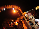 A Person Dressed Up for the 'Comparsa' or Day of the Dead Procession Photographic Print by Raul Touzon