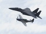 An F-15 Eagle and the P-51 Mustang Fly in Formation Photographic Print by Raul Touzon