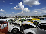 Old Volkswagen Cars in a Junkyard Photographic Print by Raul Touzon