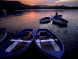 Boats on the Shore of Lake Banyoles at Sunset Photographic Print by Tino Soriano
