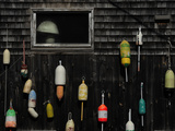 Lobster Pot Marker Floats Hang on the Side of a Building Photographic Print by Raul Touzon