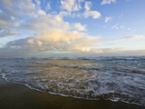 Storm Clouds Reflect Pastel Colors in Waves Rolling into Shore Photographic Print by Jason Edwards