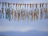Souvenir Dream Catchers Against the Sky Photographic Print by John Burcham