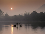 A Cormorant Fisher Works the Li River in Southern China at Dawn Photographic Print by Kenneth Ginn