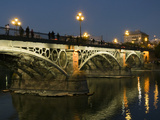 The Bridge of Triana, Puente De Triana, Illuminated at Night Fotoprint av Krista Rossow
