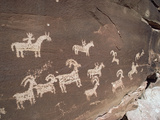 Hunting Party Petroglyphs at Wolfe Ranch, Arches National Park, Utah Photographic Print by Gerry Ellis