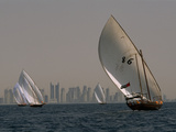 Dhow Sailboats Glide and Race across Waters of the Arabian Gulf Photographic Print by Maggie Steber