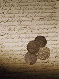 Spanish Coins Lie on a Slavery Bill of Sale Photographic Print by Maggie Steber