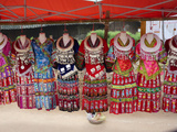 Silver Adorns Traditional Miao Tribe Dresses Hanging on Mannequins Lámina fotográfica por O. Louis Mazzatenta