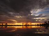 Sunset and Storm Clouds over Waterhole, Linyanti Swamp, Okavango Delta, Botswana Photographic Print by Gerry Ellis