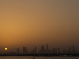Silhouette of Dubai Skyline at Sunset Photographic Print by Maggie Steber