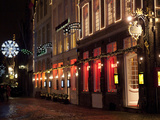 A Street Scene at Night During the Christmas Season Photographic Print by Abraham Nowitz