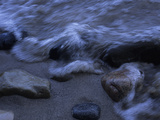 A Wave Rushes over Pebbles on the Shore of Lake Michigan Photographic Print by Paul Damien