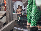 Portrait of a Child on a Boat at Tonle Sap, Cambodia Photographic Print by Kent Kobersteen