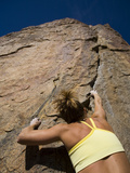 A Female Rock Climber in Joshua Tree National Park, California Photographic Print by John Burcham