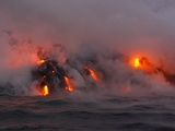 Hot Magma Spills into the Sea from under a Hardened Lava Crust Photographic Print by Patrick McFeeley