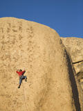 A Male Rock Climber in Joshua Tree National Park, California Photographic Print by John Burcham