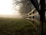 A Fence Disappears into Morning Fog in West Virginia Horse Country Photographic Print by Stephen St. John