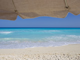 View of Turquoise Waters from Underneath a Beach Umbrella Photographic Print by Mike Theiss